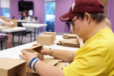 Man folding boxes