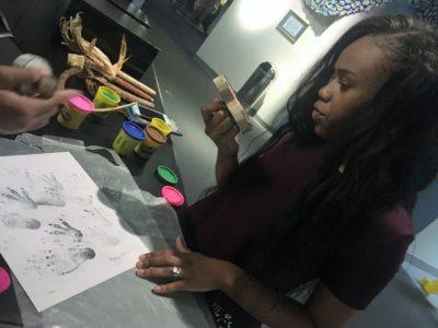 Lady doing hand print art