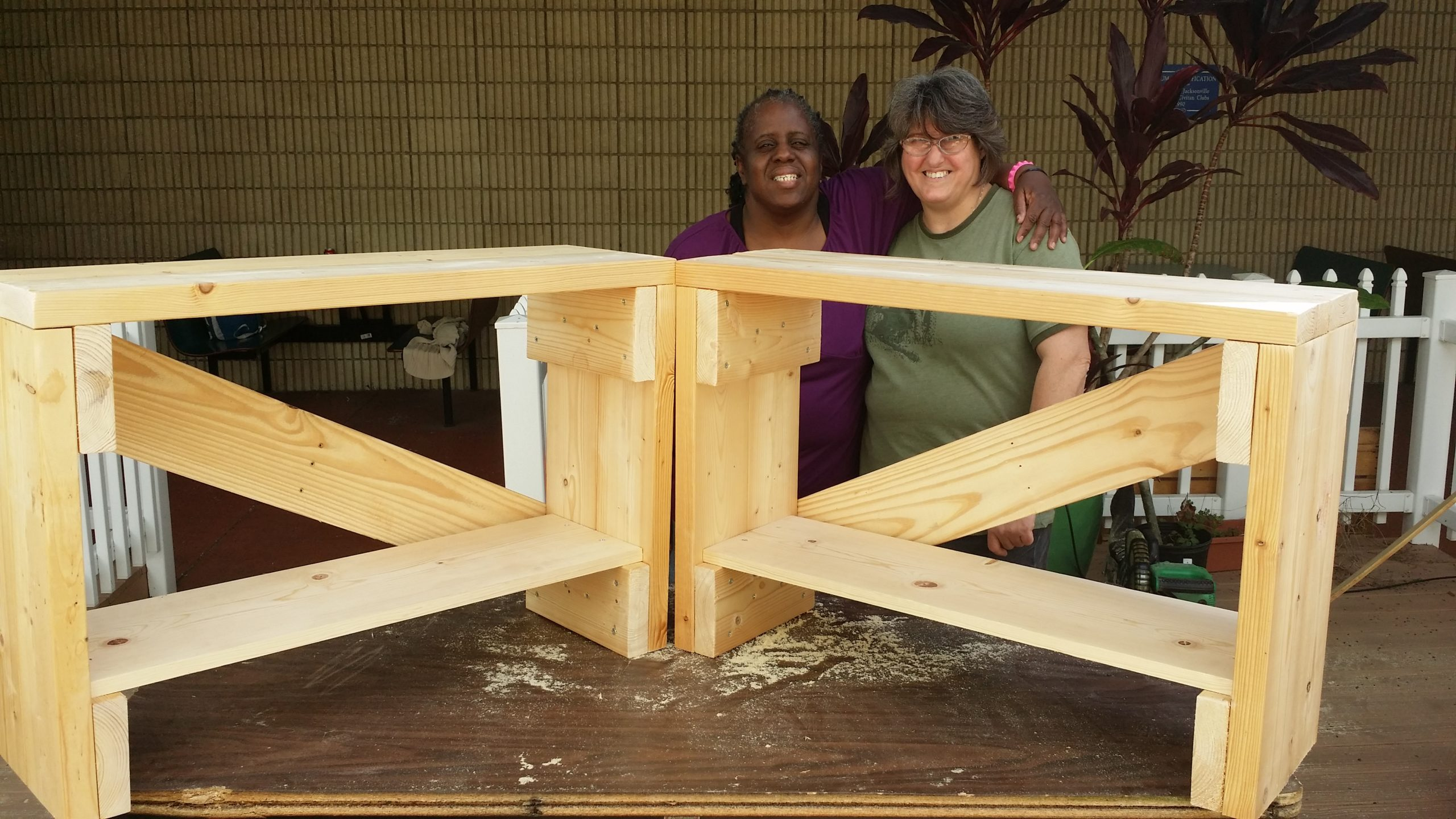 women building something with wood